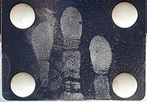 Fingerprints on door pull plate developed with concentrated silver.