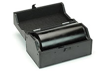 Palmprint ink roll in casing with lid opened.