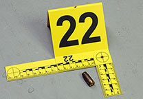 Evidence marker with cartridge case.