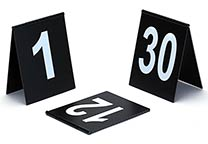 Number signs (several number ranges available), tent design, with hinge on the top. Black with white printing. Dimensions: 9 x 11 cm.